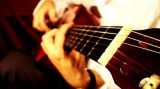 stock-footage-musician-and-acoustic-guitar-playing